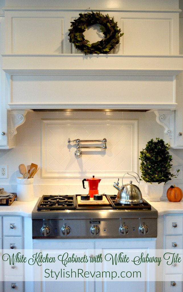 Sprayed White Cabinets with White Subway Tile and a Pot Filler