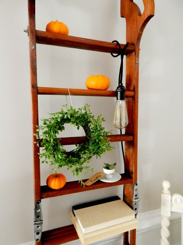 Decorating with Mini Pumpkins on a decorative ladder