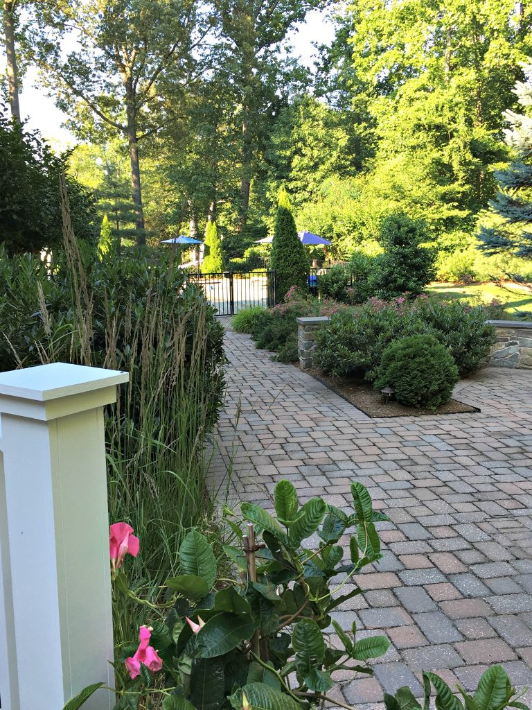 Paver walkway leading to the pool