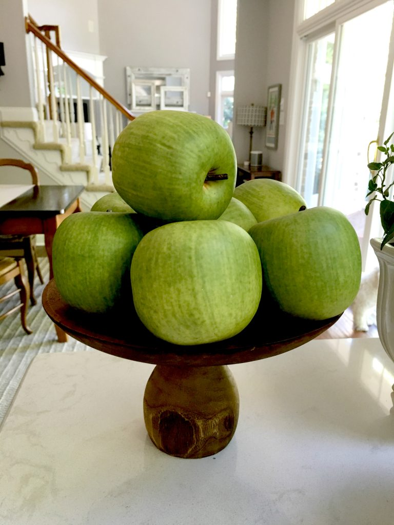 I found these decorative green apples at Goodwill. They are the perfect little accent to our white kitchen.