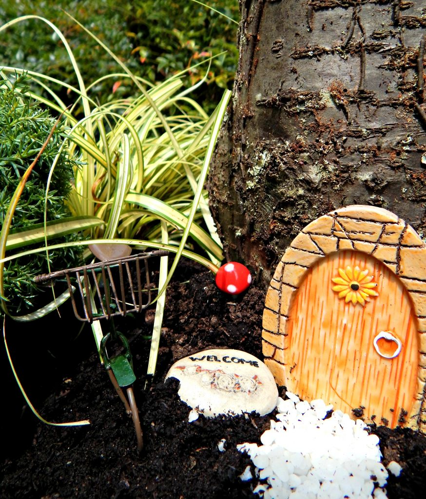 Fair Garden made from using a log and a copper tub.