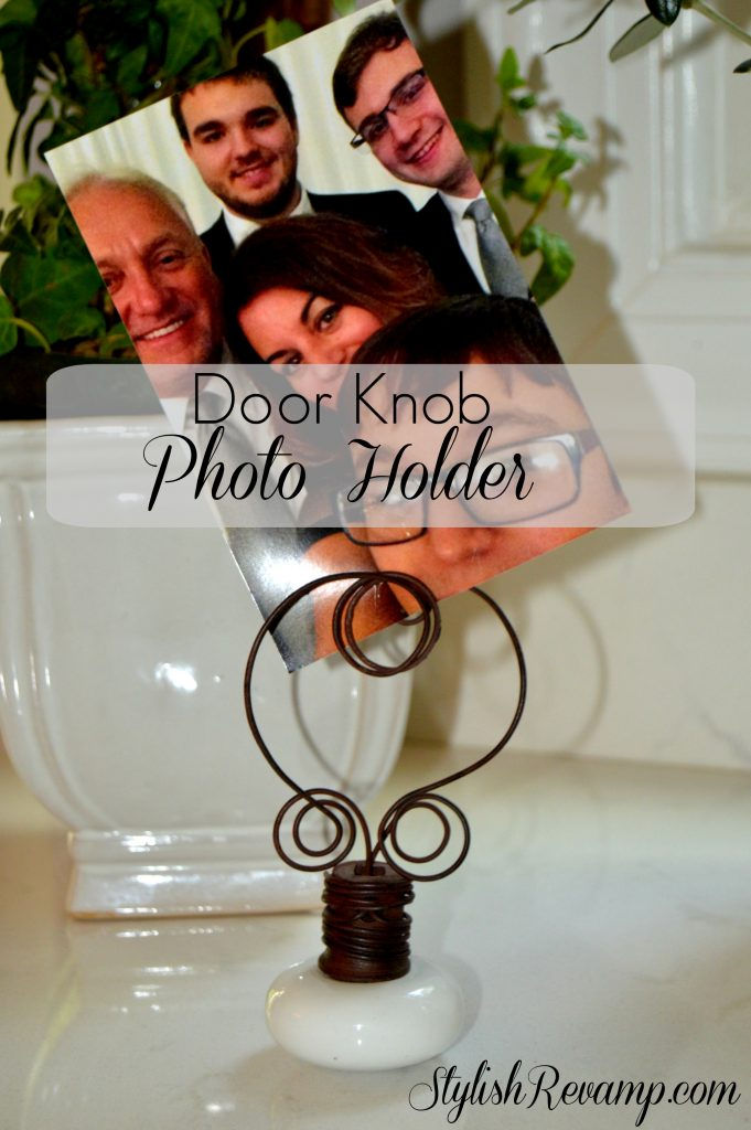 I love this vintage door knob that has been repurposed into a lovely photo holder.