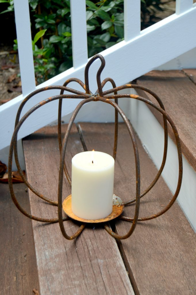 I am loving this decorative rusty metal pumpkin candle holder.