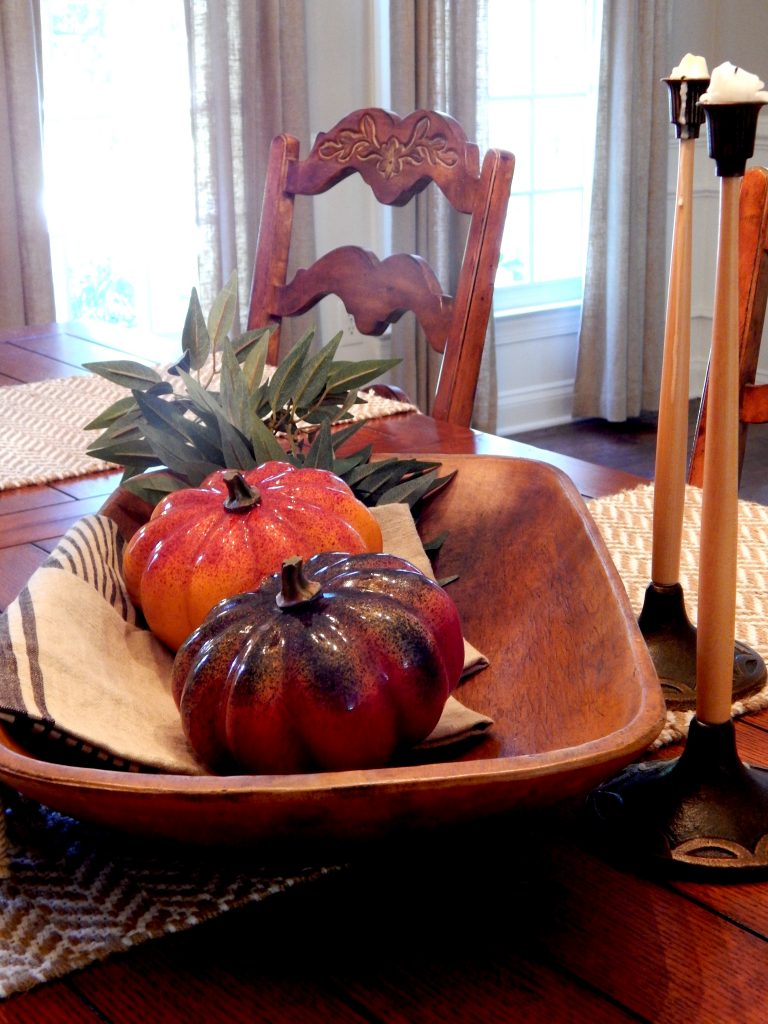 Pumpkins and wooden bread bowls