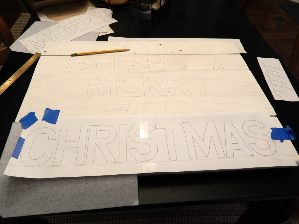 Designing a wood Christmas sign using pallets and paint pens