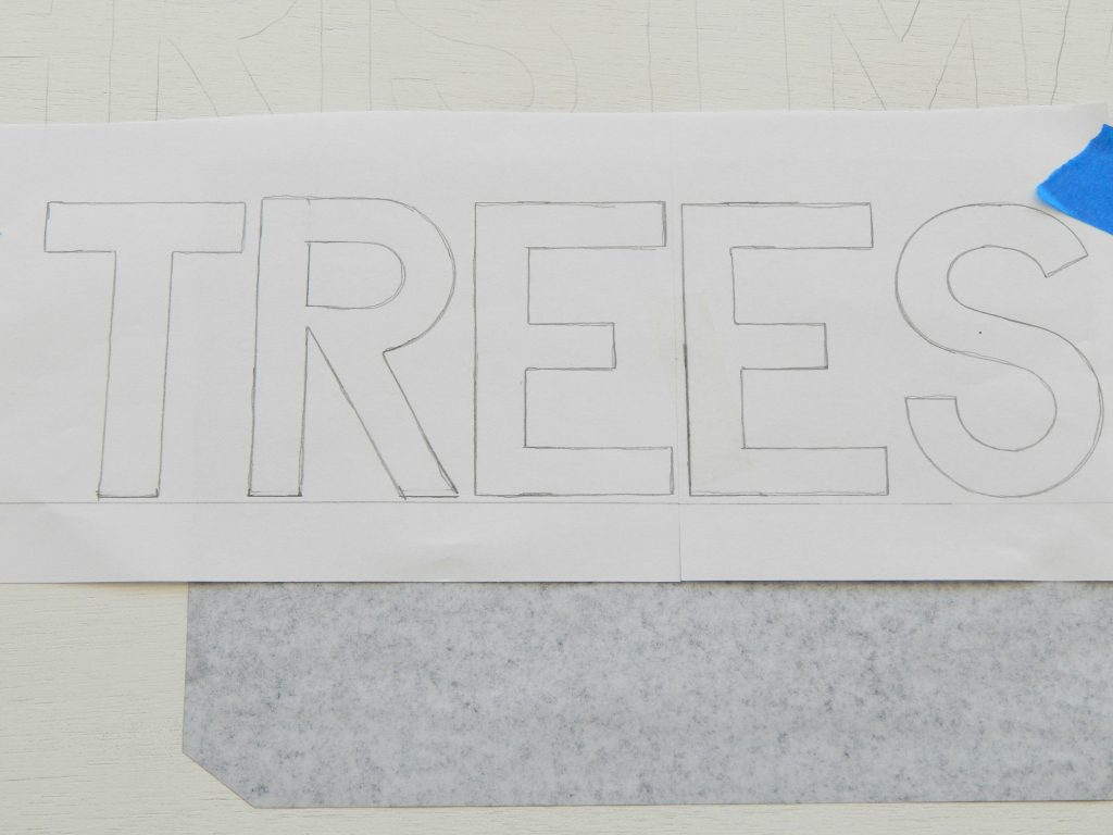 Tracing my letters using carbon paper.