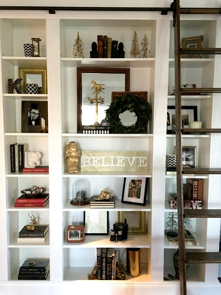 My Ikea Billy Bookcase dressed for the Holidays with touches of gold.