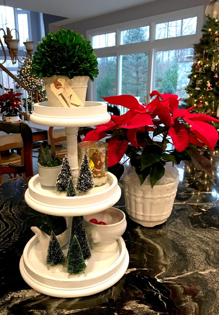 My consignment shop three tiered stand dressed for Christmas.