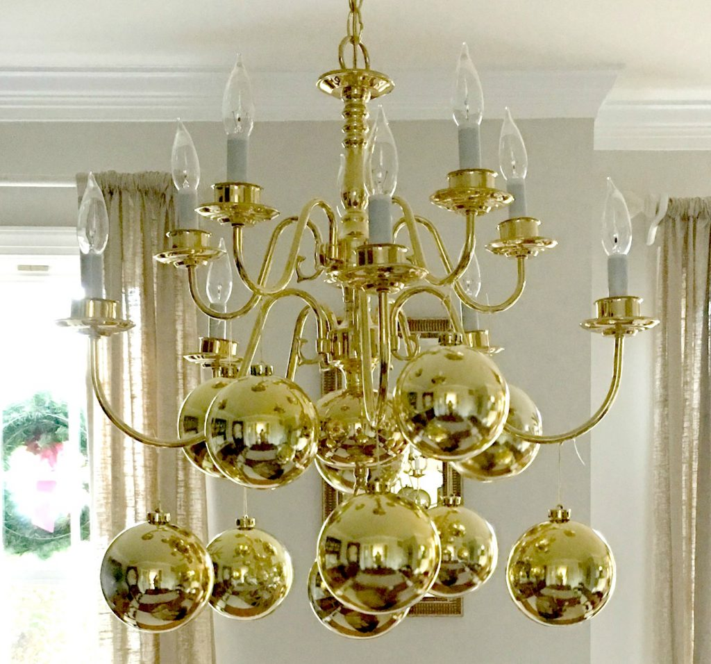 Revamping an old chandelier with ornaments from the Dollar Store