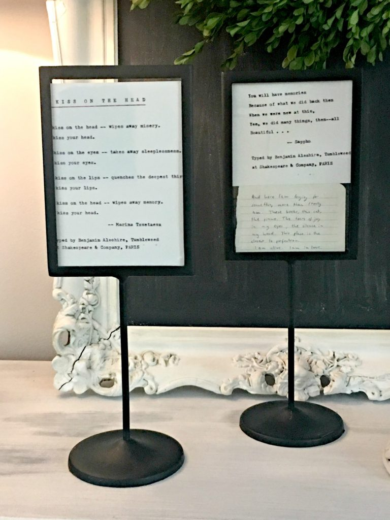 Poems from Shakespeare and Company in black iron frame
