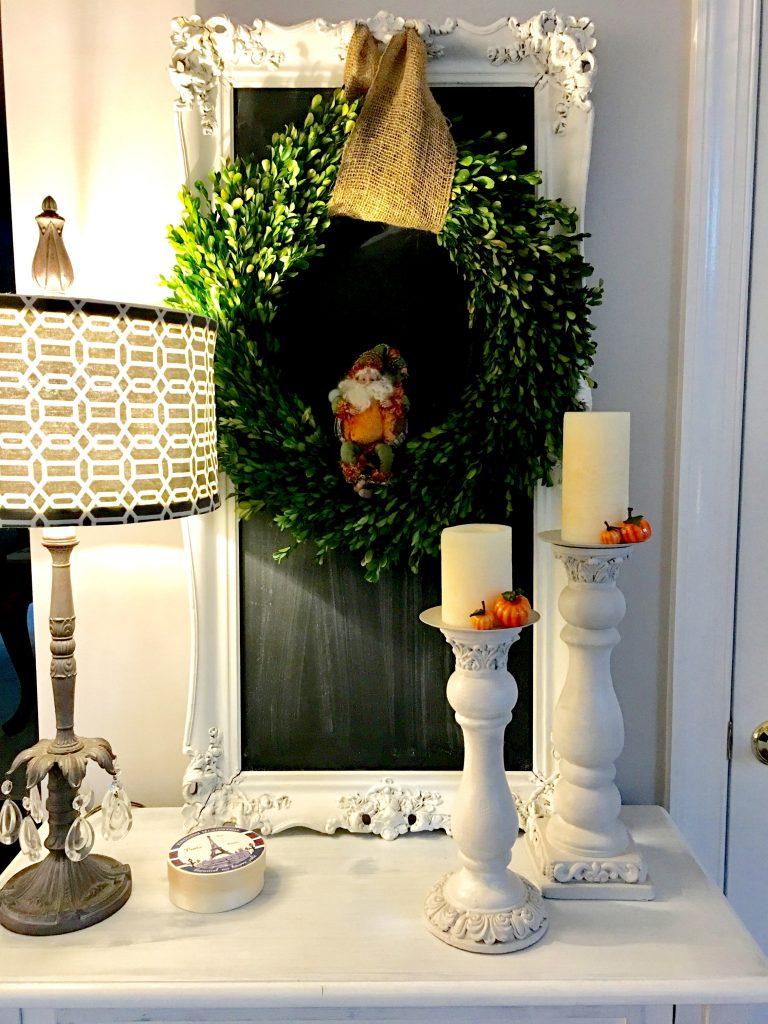 Pumpkin Fairy nestled in a wreath