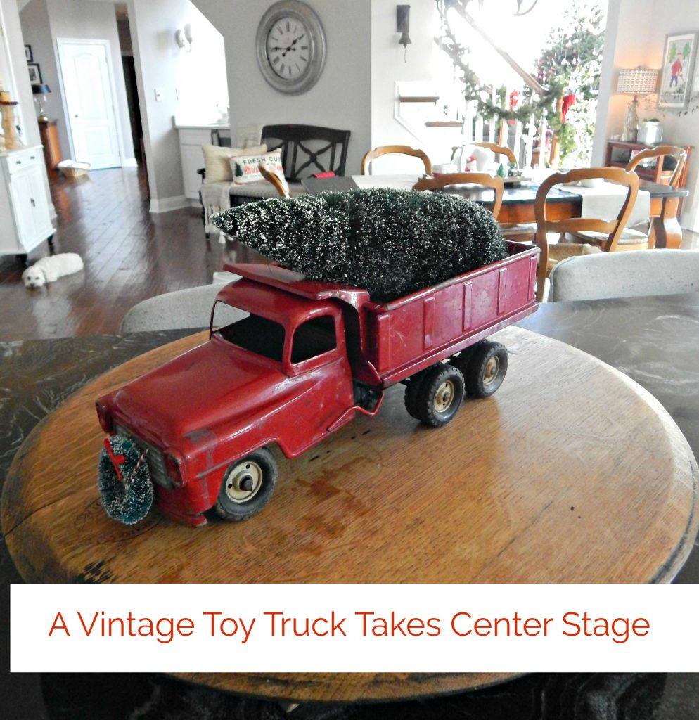 I love my husband's vintage red truck decked out for the holidays.