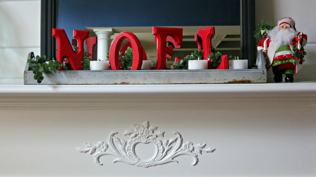 My mantle dressed for Christmas using a vintage feeder and DIY letters.