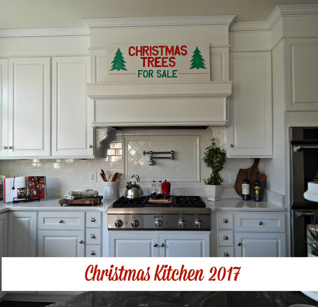 My white kitchen decked out for Christmas with pops of red.
