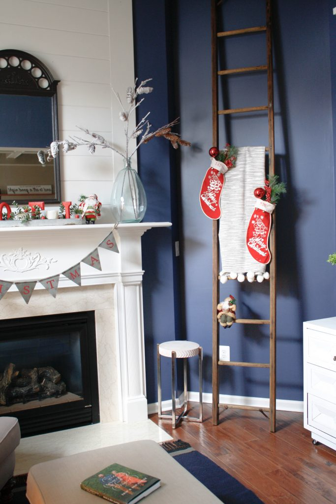 A vintage Bell Atlantic wooden ladder decked out with vintage Christmas stocking.