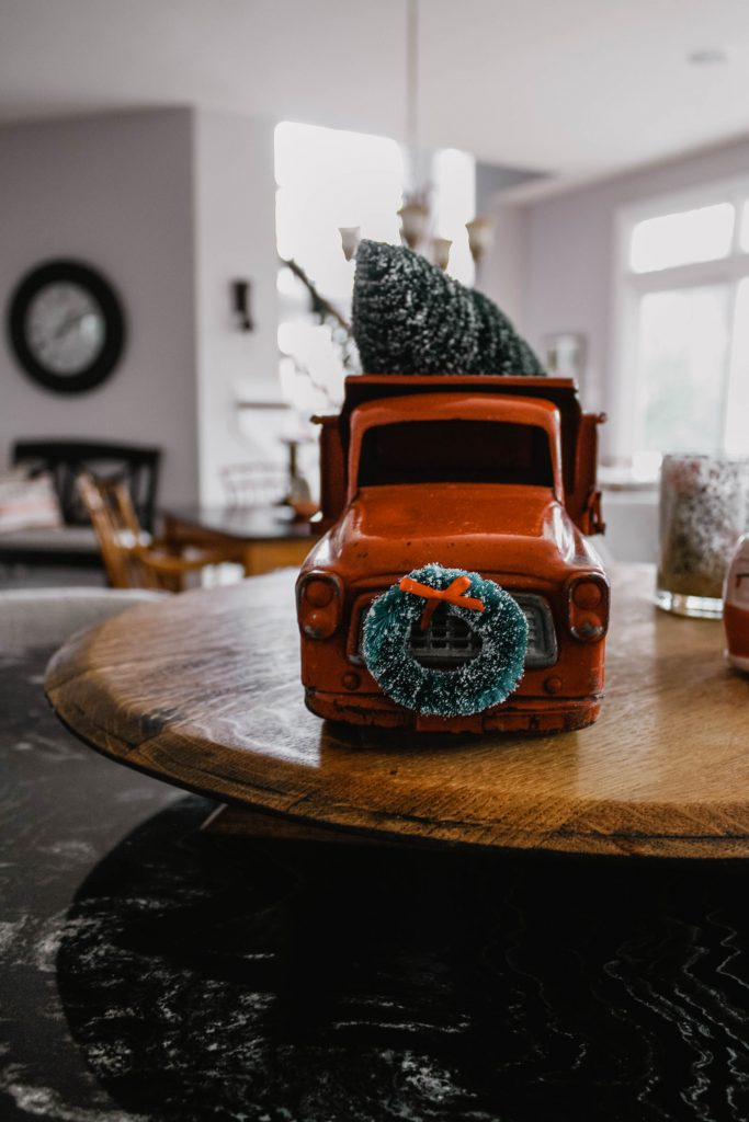 Vintage Red Toy truck carrying a Christmas tree