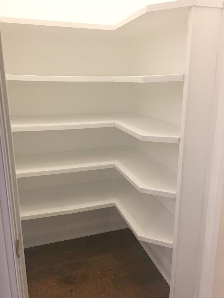 Painted and trimmed out Pantry Shelves